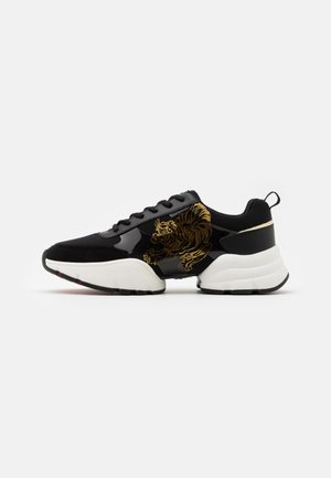 CAGED RUNNER TIGER - Sneakers basse - black/gold