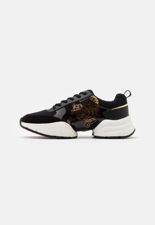 CAGED RUNNER TIGER - Matalavartiset tennarit - black/gold