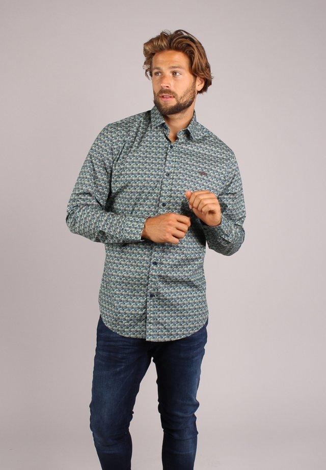 Camisa - overige