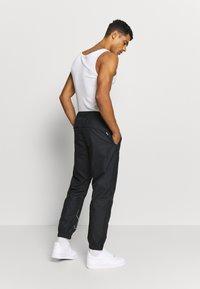 Nike SB - TRACK PANT - Spodnie treningowe - black/fossil - 2