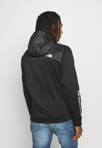 The North Face - TRAIN N LOGO OVERLAY JACKET - Veste légère - black / asphalt grey - 2