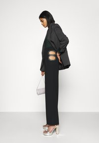 Nly by Nelly - CUT OUT PANTS - Trousers - black - 3
