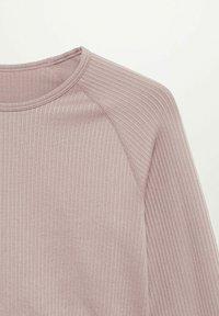 Mango - APOLINA - Long sleeved top - licht/pastelpaars - 8