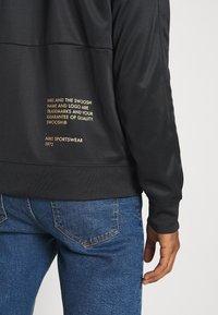Nike Sportswear - Training jacket - black/gold foil - 5