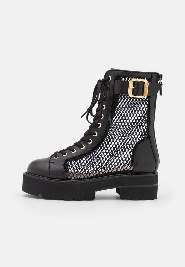 NETTA ULTRALIFT BOOT - Platform ankle boots - black