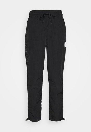 AOKI TOGGLE CUFF PANT - Tracksuit bottoms - black
