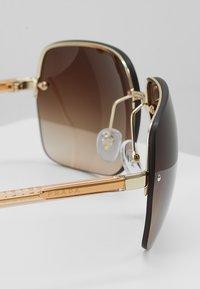 Prada - Sonnenbrille - gold/brown - 4