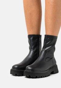 Call it Spring - VEGAN FIERRCE - Platform ankle boots - black - 0