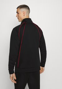 Jordan - JUMPMAN AIR SUIT - Kevyt takki - black/gym red - 2