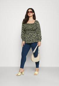 Vero Moda Curve - VMLUDY - Slim fit jeans - blue denim - 1