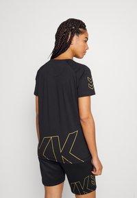 Hummel - CIMA XK WOMAN - Print T-shirt - black - 2