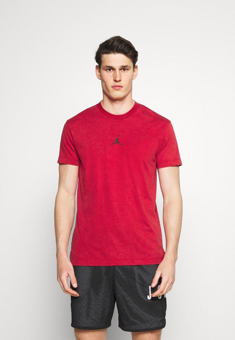 Jordan - DRY AIR - Basic T-shirt - gym red/black
