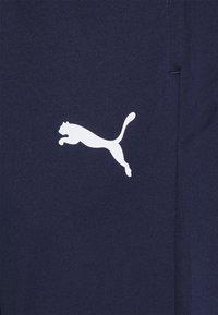 Puma - TEAMRISE TRAINING PANTS - Spodnie treningowe - peacoat/white - 2
