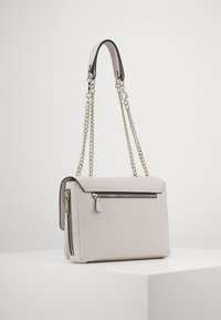 Guess - CHAIN CONVERTIBLE XBODY FLAP - Across body bag - stone - 2