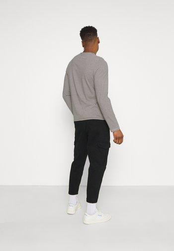 JACOB PANTS - Cargo trousers - black