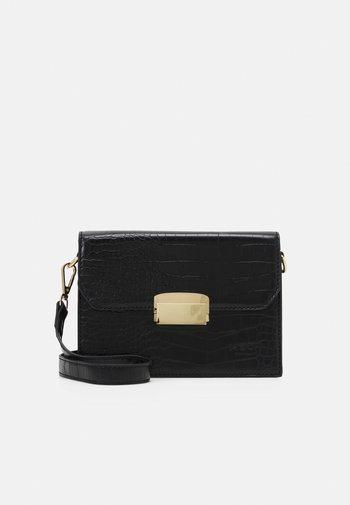 ODINA CROSSOVER BAG - Across body bag - black