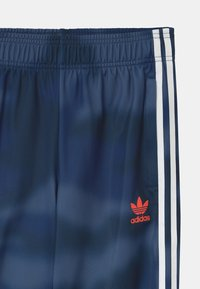 adidas Originals - CAMO SUPERSTAR UNISEX - Tracksuit bottoms - crew blue/white - 2