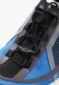 adidas by Stella McCartney - PULSEBOOST HD S. - Neutral running shoes - bright royal/utility black/footwear white - 5