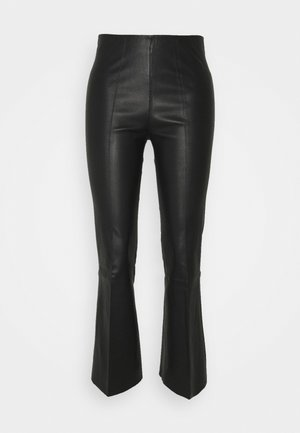 PHASE - Leather trousers - black