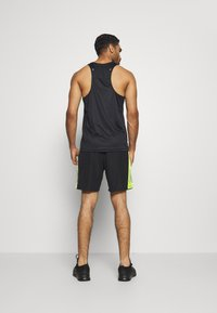 adidas Performance - OWN THE RUN - Sports shorts - black/signal green - 2