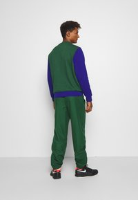 Lacoste Sport - TENNIS PANT - Pantalon de survêtement - green - 2