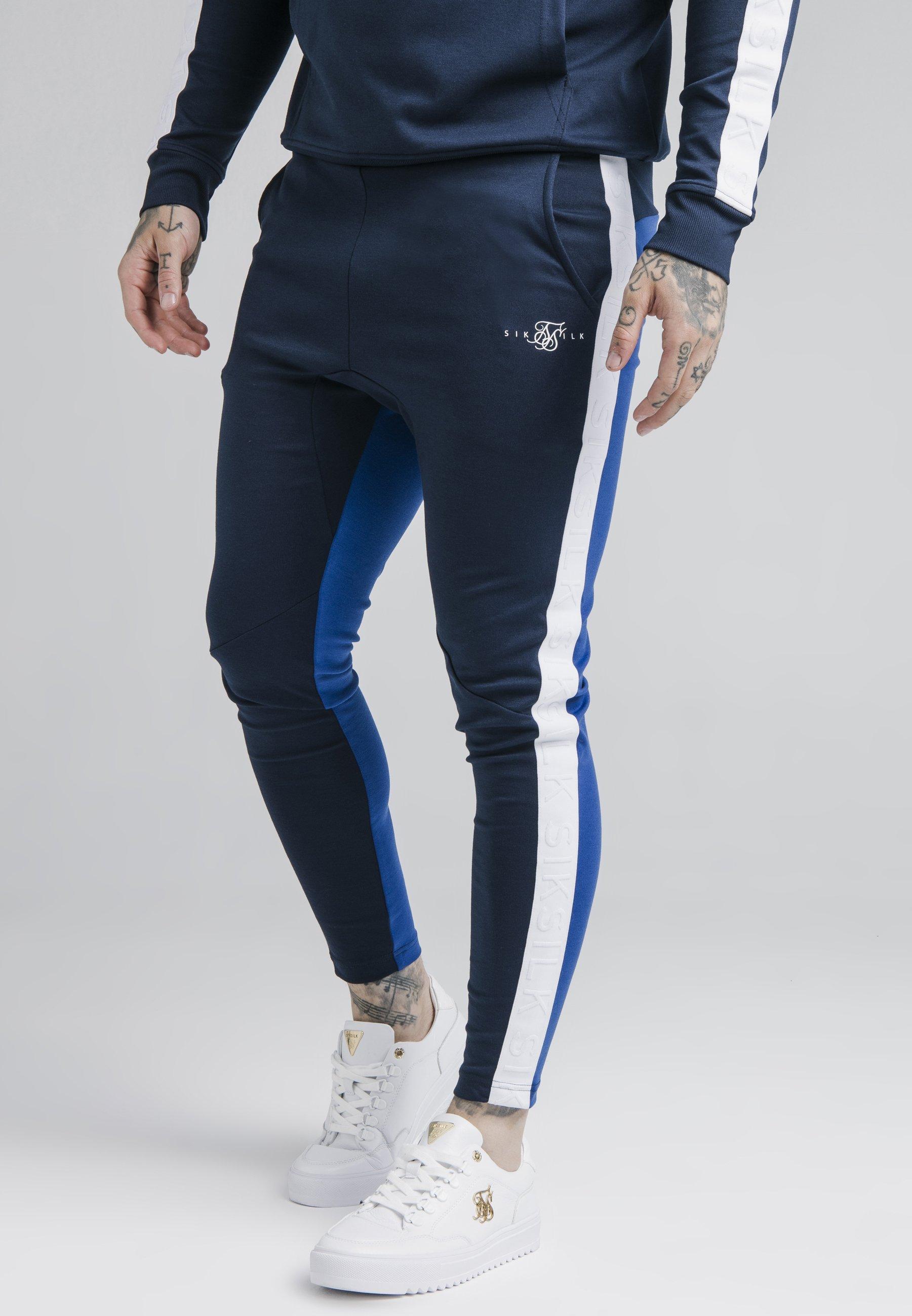 Men INVERSE TAPE TRACK PANTS - Tracksuit bottoms