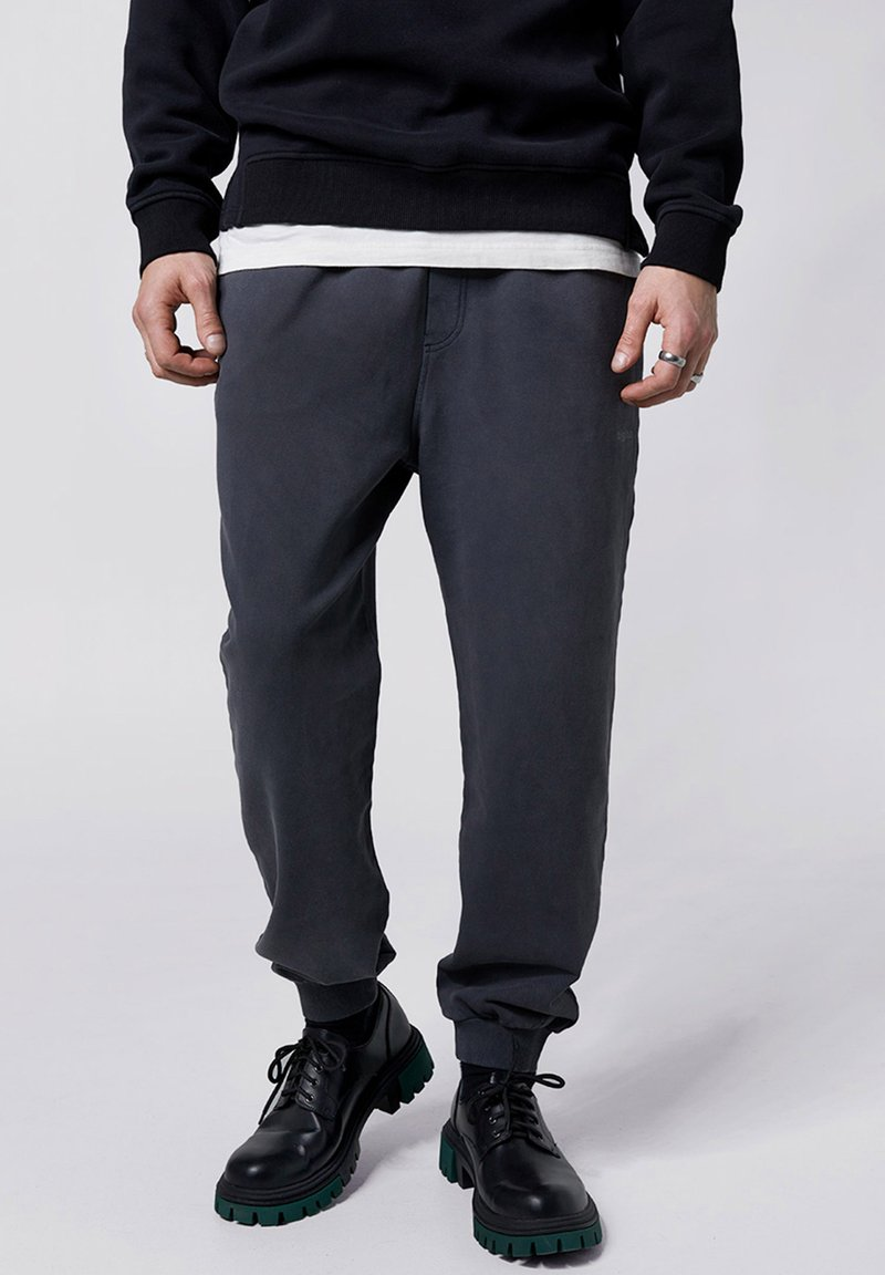 Tigha - COSMO - Tracksuit bottoms - vintage black