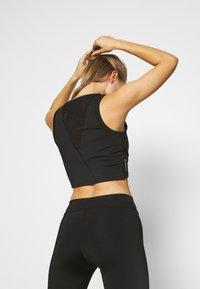 Puma - STUDIO CROP - Sports shirt - black - 2
