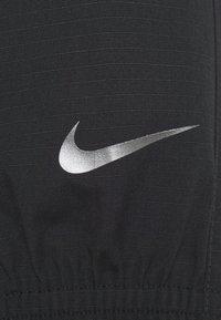 Nike Sportswear - Summer jacket - black/dark smoke grey - 6