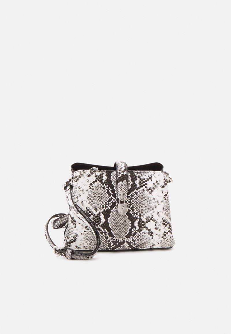 Calvin Klein - XBODY PYTHON - Across body bag - grey