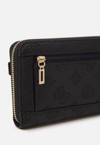 Guess - BEA LARGE ZIP AROUND - Wallet - black - 3