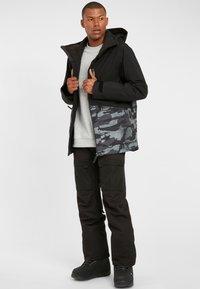 O'Neill - TEXTURE JACKET - Snowboard jacket - black out - 1
