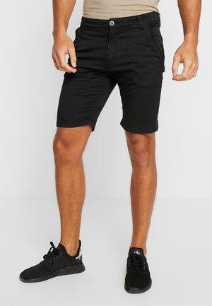 KEROSENE - Shorts - black
