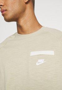 Nike Sportswear - T-shirt basic - grain/coconut milk/white - 4