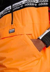 adidas Originals - REVEAL YOUR VOICE - Windbreakers - flash orange - 6