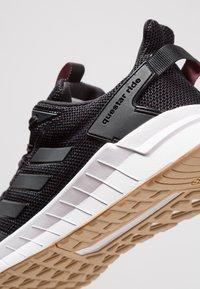 adidas Performance - QUESTAR RIDE - Juoksukenkä/neutraalit - core black/grey five - 5