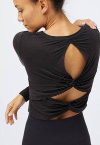 OYSHO - Long sleeved top - black - 1