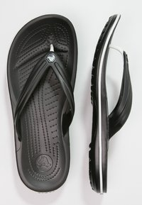 Crocs - CROCBAND FLIP UNISEX - Pool shoes - black - 1