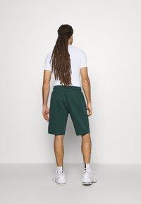 Under Armour - ROCK SHORT - Sports shorts - ivy - 2
