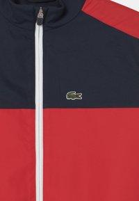 Lacoste - LOGO - Training jacket - navy blue/redcurrant bush - 2