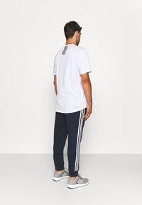 adidas Performance - 3 STRIPES  ESSENTIALS - Tracksuit bottoms - legend ink/white - 2