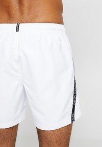 Calvin Klein Swimwear - MEDIUM DRAWSTRING - Swimming shorts - white - 1