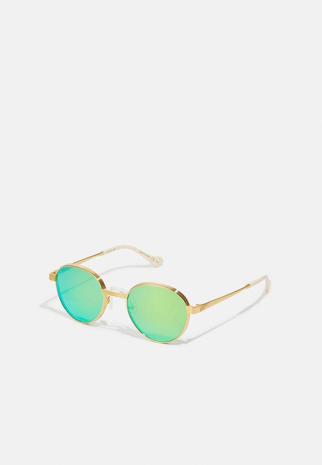 UNISEX - Occhiali da sole - gold-coloured/green