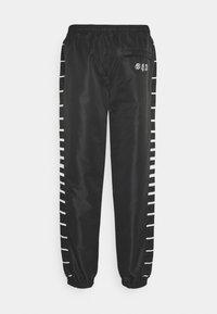 Grimey - GRMY X GZUZ UNISEX TRACK PANTS - Teplákové kalhoty - black - 1