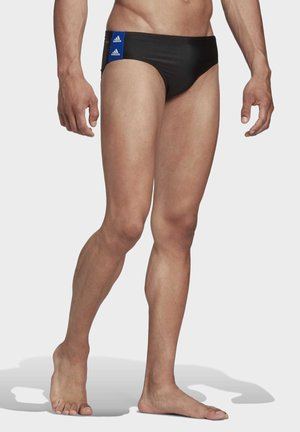 TAPERED SWIM TRUNKS - Swimming briefs - black