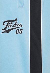 FUBU - VARSITY TRACK PANTS - Pantaloni sportivi - lightblue - 2