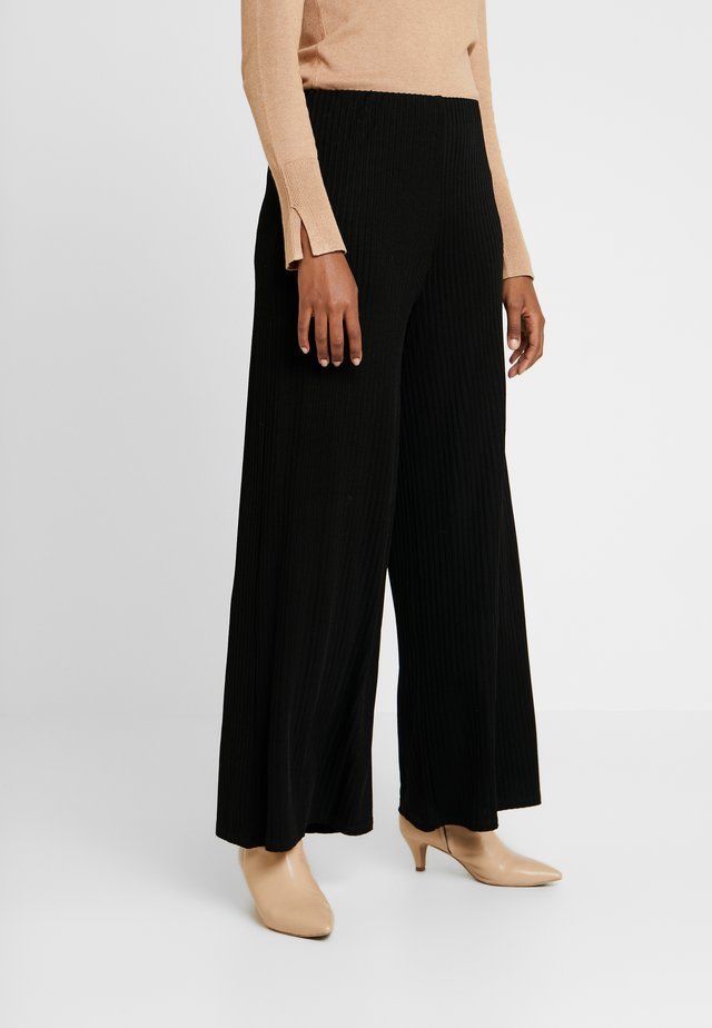 ADELAIDE - Trousers - black