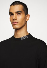 HUGO - DOTCH - T-shirt à manches longues - black - 5