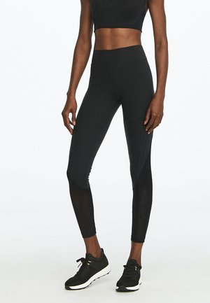 FORMENDE LEGGINGS MIT TRANSPARENTEN DETAILS 31217222 - Leggings - black