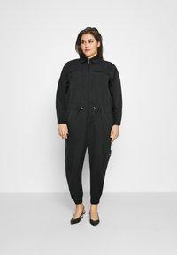 Nike Sportswear - UTILITY - Jumpsuit - black/white - 1